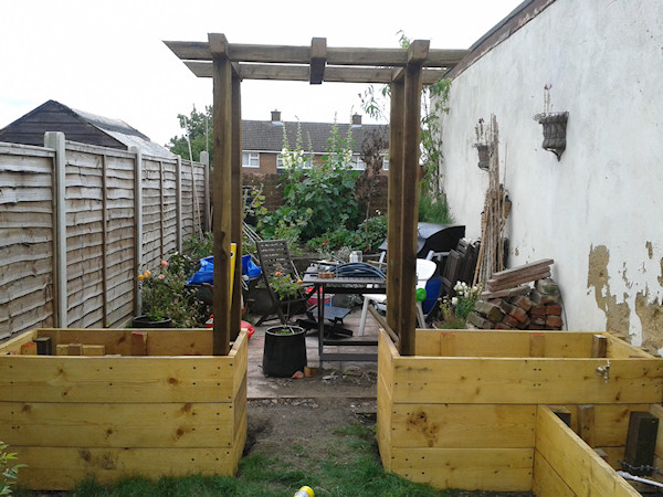 Raised beds building complete rambling red head for Garden decking jewsons
